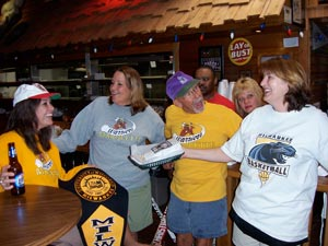 Yes, we can all get along. Sports fans of many different teams peacefully coexist at Major Goolsby's.